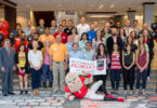 UGA President Jere W. Morehead poses with participants of this year's New Faculty Tour prior to their departure Aug. 5.